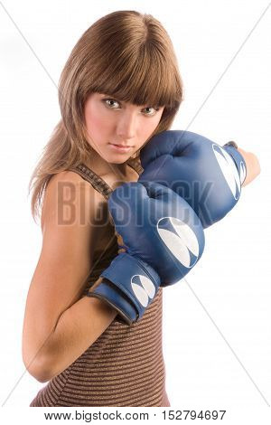 Active young female in blue boxing gloves hold hands near her face