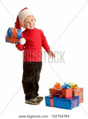 Little boy is standing and holding a gift box; isolated on white background