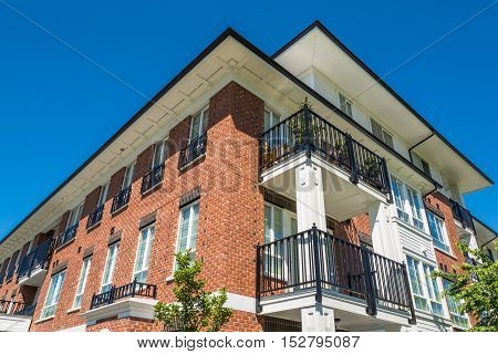 The top of brand new apartment building on blue sky background in British Columbia Canada