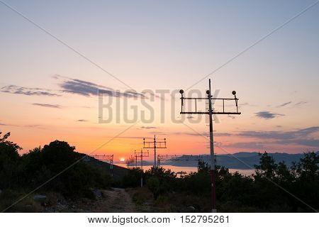landing lights of Dubrovnik airport at sunset