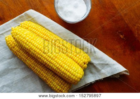 just cooked corn with salt on table rustic concept