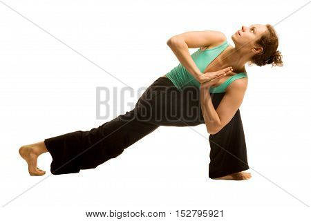 Young woman doing yoga pose .Isolated on white