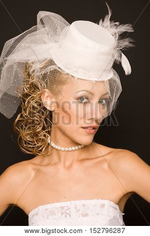 Stunning bride dressed in retro style on the black background