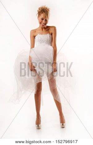 Fascinating standing bride. Isolated on white background