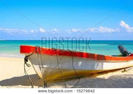 "Boat named ""Escape"" on a tropical beach."