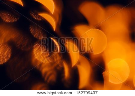 Bokeh dark orange semicircles on black background. Abstract warm background.