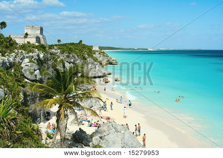 Beautiful beach in Tulum Mexico, Mayan ruins on top of the cliff.