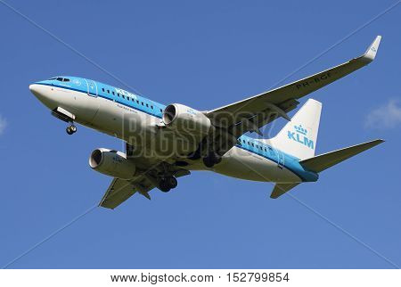 SAINT PETERSBURG, RUSSIA - JULY 24, 2015: The Boeing 737-700 (PH-BKZ) airlines KLM Royal Dutch airlines before landing in Pulkovo airport