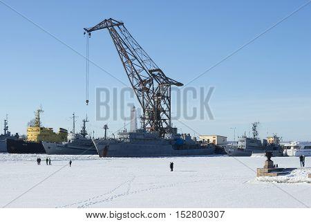 KRONSTADT, RUSSIA - FEBRUARY 15, 2015: Winter day in Petrovskaya Harbor. Historical landmark of the Kronstadt