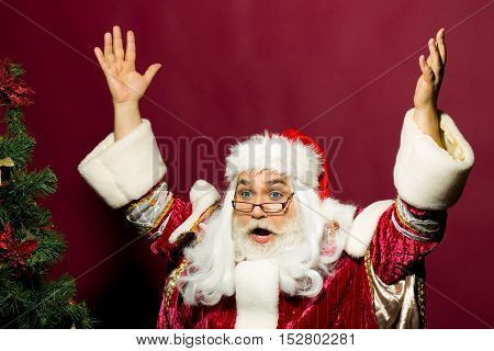 Amazed Santa Puts Up Hands