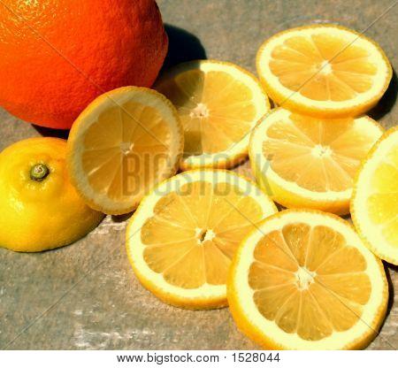 Lemon Slices And An Orange