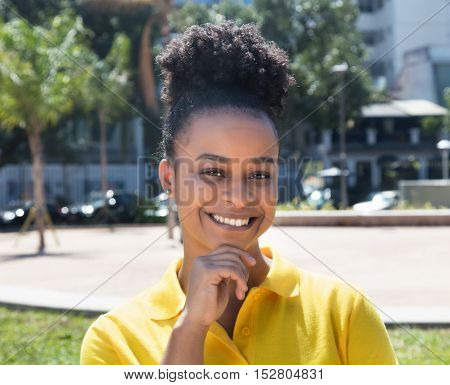Laughing woman with amazing hairstyle in the city