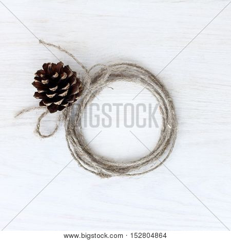 flat layout of the rope tied to the knob and the free space inside the top view / festive background frame