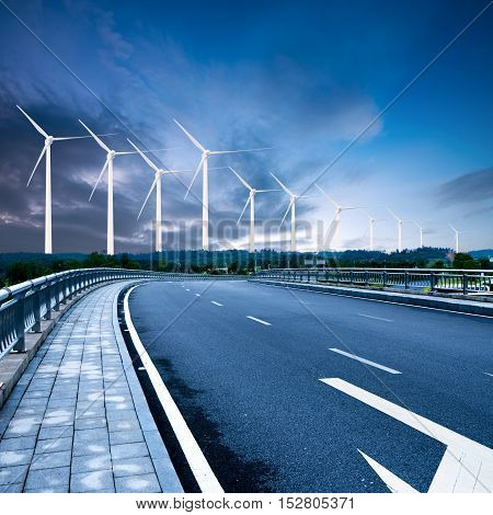 Modern road construction, highways and wind turbines.