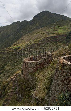 Inca ruin old watchtower in andes landscape, Urubamba valley