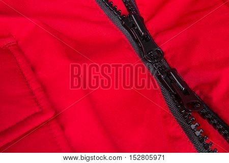 Fragment Of Red Jacket With Black Zipper. Ziplock Background. Close Up.