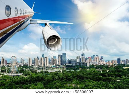 The plane flew over the modern city of Shanghai, China.