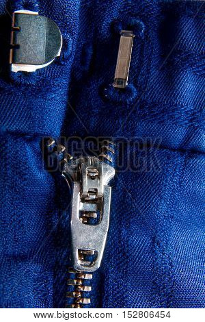 Fragment Of Blue Jacket With Metal Zipper. Ziplock Background. Close Up.