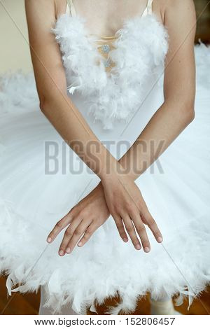 Closeup of ballerina's hands while she is dancing the Swan Lake.