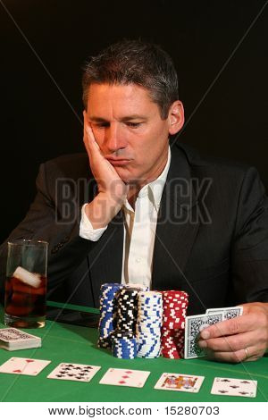 Poker player contemplating his next move.