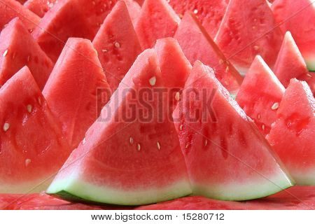 Background of brightly lit watermelon slices.