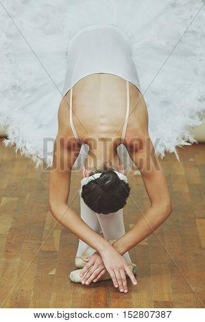 Closeup of ballerina while she is dancing the Swan Lake in studio.