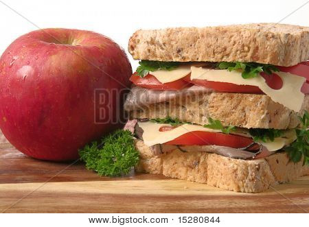 Roast beef sandwich and apple.