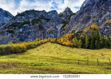 Alps autumn colorful mountain landscape with blue cloudy sky. Austria Tyrol.