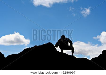 Mountain top hiker silhouette