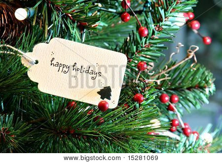 Happy holidays card in a Christmas tree.