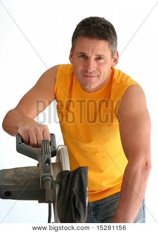 Carpenter using a circular saw.