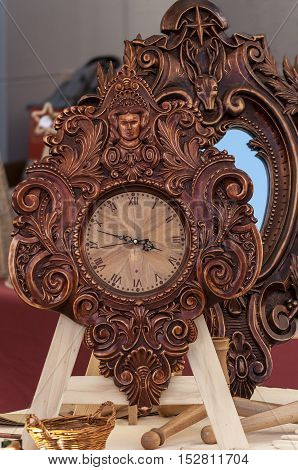 Floral woodwork analogue antique clock. Wooden frame