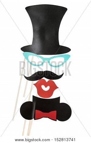 fashion accessories for a fun holiday of paper, lips, mustaches, hats isolated on white background