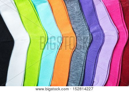 Textile colorful socks background. Green, pink, red, white and other colors
