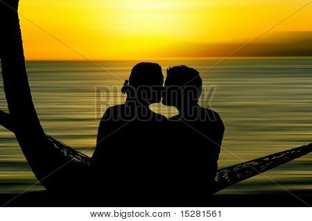 Kissing couple silhouette at sunset