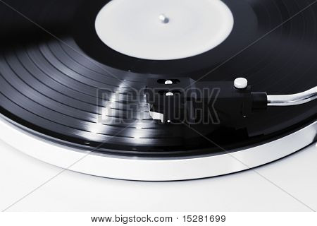 turn table, vinyl player, focus on the needle, the record is spinning.