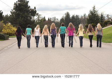 Ten beautiful girls, walking together hand in hand.
