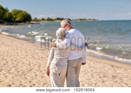 family, age, travel, tourism and people concept - happy senior couple hugging on summer beach