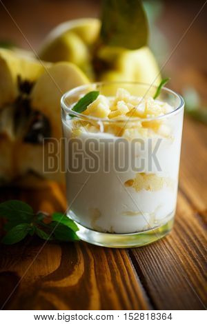 Greek yogurt with baked quince in a glass