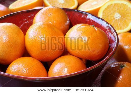 Fruit still life, perfect unblemished oranges.
