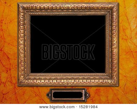 Antique picture frame and plaque on old textured wallpaper. Add your own picture and  text.