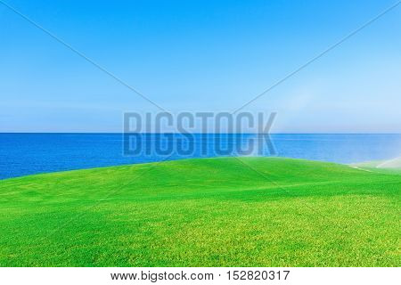 automatic watering the green grass on the golf course