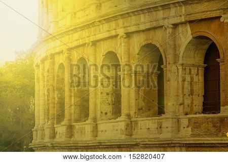 Exterior of the Flavian Amphitheatre Colosseum, in Rome, Italy, morning sun filter applied