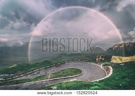 Amazing rainbow on the top of grossglockner pass, Alps, Switzerland, Europe, toned like Instagram filter