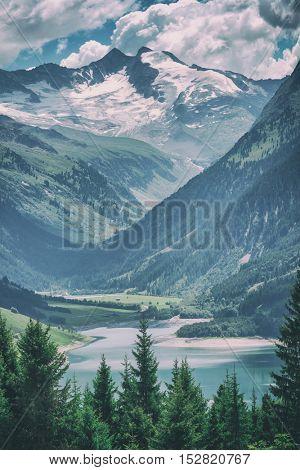 Amazing summer morning on the fantastic Speicher Durlassboden lake. Alps, Austria, Europe, toned like Instagram filter