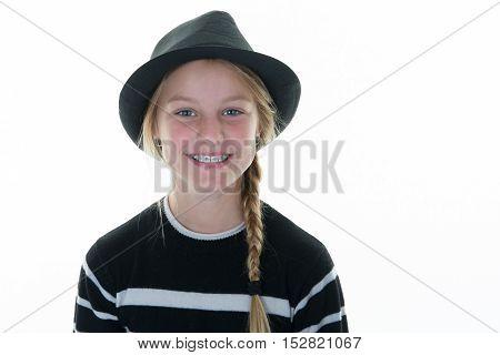 Smiling Blond Girl Dressed In Black Wearing Top Hat