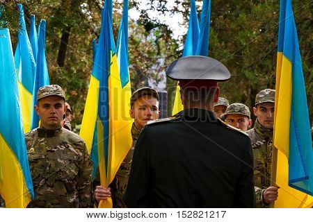 Uzhgorod Ukraine - October 14 2016: Soldiers of the National Guard hold flags of Ukraine during the celebration the Day of Defender of the Fatherland. This day Ukraine celebrates the Day of Defender of the Fatherland.