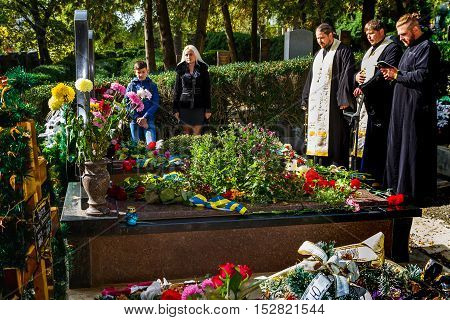Uzhgorod, Ukraine - October 14, 2016: The priests pray at the graves of soldiers who died in the ATO zone during the celebration the Day of Defender of the Fatherland . This day Ukraine celebrates the Day of Defender of the Fatherland.