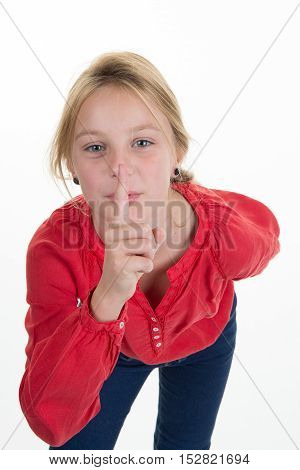 Blond Girl In Red Putting Finger Up To Lips, Silence