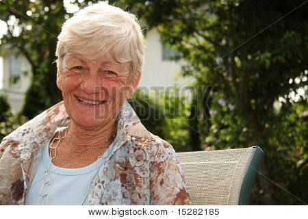 Smiling stylish lady in her sixties.